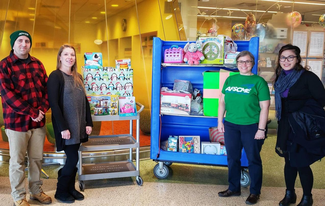 Local 3800 members Brad Sigal, Janaya Martin, Cherrene Horazuk and Marie Dino show off the toys they collected for the U of M's Masonic Children's Hospital